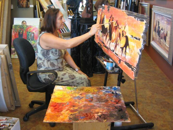 Ekaterina painting at the gallery